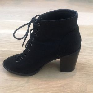Lace up black heeled booties